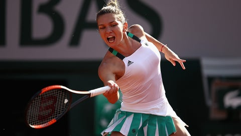 PARIS, FRANCE - JUNE 08:  Simona Halep of Romania plays a forehand during ladies singles semi-final match against Karolina Pliskova of The Czech Republic on day twelve of the 2017 French Open at Roland Garros on June 8, 2017 in Paris, France.  (Photo by Julian Finney/Getty Images)