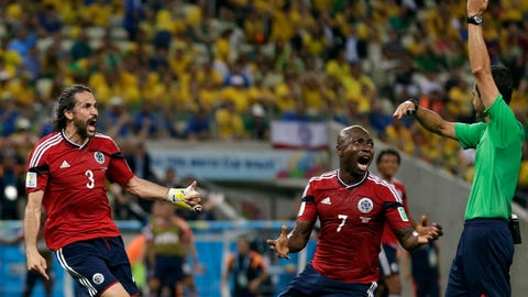 Colombia's Mario Yepes, left, and Pablo Armero remonstrate with referee Carlos Velasco Carballo from Spain after he disallowed a goal during the World Cup quarterfinal soccer match between Brazil and Colombia at the Arena Castelao in Fortaleza, Brazil, Friday, July 4, 2014. (AP Photo/Felipe Dana)