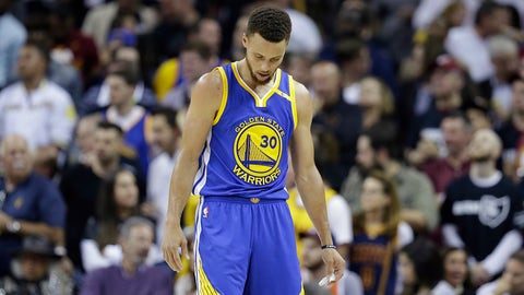 Golden State Warriors guard Stephen Curry walks to the bench during the second half against the Cleveland Cavaliers in Game 4 of basketball's NBA Finals in Cleveland, Friday, June 9, 2017. (AP Photo/Tony Dejak)