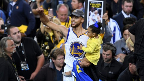 OAKLAND, CA - JUNE 12:  Stephen Curry #30 of the Golden State Warriors celebrates holding his daughter Ryan after defeating the Cleveland Cavaliers 129-120 in Game 5 to win the 2017 NBA Finals at ORACLE Arena on June 12, 2017 in Oakland, California. NOTE TO USER: User expressly acknowledges and agrees that, by downloading and or using this photograph, User is consenting to the terms and conditions of the Getty Images License Agreement.  (Photo by Thearon W. Henderson/Getty Images)