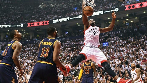 Toronto Raptors forward Serge Ibaka (9) dunks as Cleveland Cavaliers guard JR Smith (5) and center Tristan Thompson (13) look on during the first half of Game 3 of an NBA basketball second-round playoff series in Toronto on Friday, May 5, 2017. (Frank Gunn/The Canadian Press via AP)