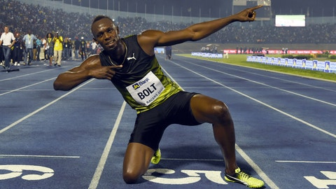 TOPSHOT - Usain Bolt (C) of Jamaica reacts after winning his final race in home country during the Racers Grand Prix at the national stadium in Kingston, Jamaica, on June 10, 2017. Bolt partied with his devoted fans in an emotional farewell at the National Stadium on June 10 as he ran his final race on Jamaican soil. Bolt is retiring in August following the London World Championships. / AFP PHOTO / Jewel SAMAD        (Photo credit should read JEWEL SAMAD/AFP/Getty Images)