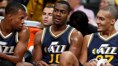 From left, Utah Jazz guard Rodney Hood (5) and Utah Jazz guard Alec Burks (10) sit on bench with Utah Jazz center Rudy Gobert (27), of France, in the second half of an NBA basketball game Thursday, Nov. 5, 2015, in Denver. Utah won 96-84. (AP Photo/David Zalubowski)