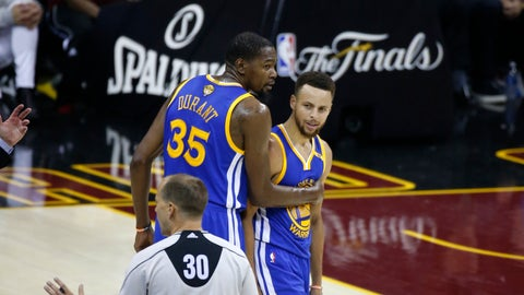 Golden State Warriors forward Kevin Durant (35) holds back Stephen Curry (30) from referee John Goble (30) in the first half against the Cleveland Cavaliers of Game 4 of basketball's NBA Finals in Cleveland, Friday, June 9, 2017. (AP Photo/Ron Schwane)
