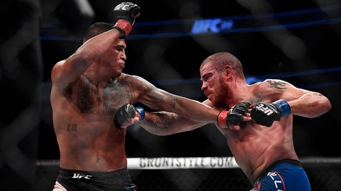 July 8, 2017; Las Vegas, NV, USA; Anthony Pettis (red gloves) fights Jim Miller (blue gloves) during UFC 213 at T-Mobile Arena. Mandatory Credit: Kyle Terada-USA TODAY Sports