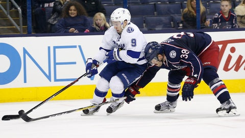 Tampa Bay Lightning's Tyler Johnson, left, carries the puck up ice as Columbus Blue Jackets' Boone Jenner defends during the third period of an NHL hockey game Tuesday, Nov. 29, 2016, in Columbus, Ohio. The Blue Jackets defeated the Lightning 5-1. (AP Photo/Jay LaPrete)