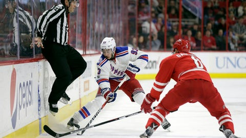 New York Rangers' Mika Zibanejad (93), of Sweden, moves the puck upice while Carolina Hurricanes' Klas Dahlbeck (6), of Sweden, defends during the first period of an NHL hockey game in Raleigh, N.C., Thursday, March 9, 2017. (AP Photo/Gerry Broome)