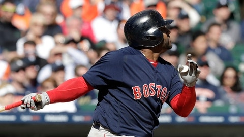Boston Red Sox's Pablo Sandoval follows through on his three-run home run during the eighth inning of a baseball game against the Detroit Tigers, Friday, April 7, 2017, in Detroit. (AP Photo/Carlos Osorio)