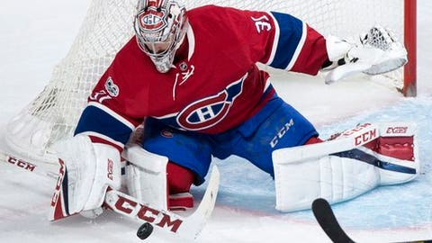 Montreal Canadiens goalie Carey Price blocks a New York Rangers shot during the first period of Game 5 of a first-round NHL hockey Stanley Cup playoff series, Thursday, April 20, 2017, in Montreal. (Paul Chiasson/The Canadian Press via AP)