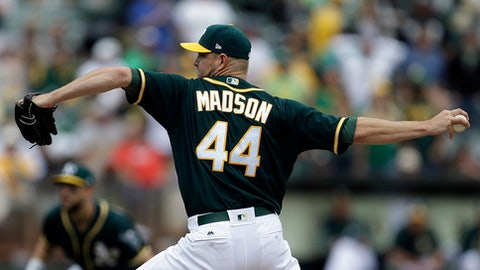 Oakland Athletics pitcher Ryan Madson works against the Seattle Mariners in the ninth inning of a baseball game Saturday, April 22, 2017, in Oakland, Calif. (AP Photo/Ben Margot)