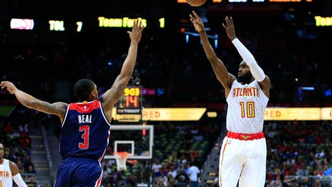 ATLANTA, GA - APRIL 22: Tim Hardaway Jr. #10 of the Atlanta Hawks shoots over Bradley Beal #3 of the Washington Wizards during the first quarter in Game Three of the Eastern Conference Quarterfinals during the 2017 NBA Playoffs at Philips Arena on April 22, 2017 in Atlanta, Georgia. NOTE TO USER: User expressly acknowledges and agrees that, by downloading and or using the photograph, User is consenting to the terms and conditions of the Getty Images License Agreement. (Photo by Daniel Shirey/Getty Images)