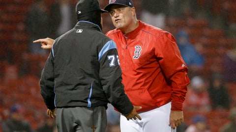Boston Red Sox manager John Farrell (53) argues with umpire Alfonso Marquez (72) during the ninth inning of a baseball game against the Texas Rangers at Fenway Park in Boston, Thursday, May 25, 2017. (AP Photo/Mary Schwalm)
