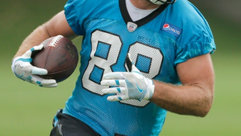 Carolina Panthers' Greg Olsen (88) runs after a catch during practice during the NFL football team's organized team activities in Charlotte, N.C., Tuesday, May 30, 2017. (AP Photo/Chuck Burton)