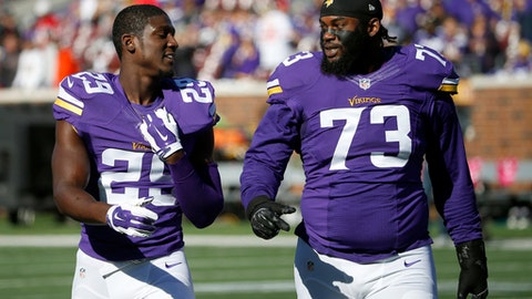 FILE - In this Sunday, Oct. 15, 2015 file photo, Minnesota Vikings cornerback Xavier Rhodes (29) and defensive tackle Sharrif Floyd (73) walk on the field before an NFL football game against the Kansas City Chiefs in Minneapolis. Minnesota Vikings defensive tackle Sharrif Floyd remains sidelined indefinitely because of complications from surgery on his right knee last September. The 2013 first-round draft pick spoke to reporters Wednesday, May 31, 2017 for the first time in more than six months, after watching practice. (AP Photo/Ann Heisenfelt, File)
