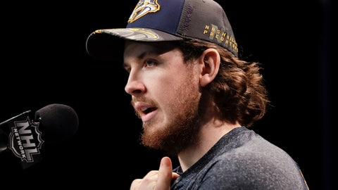 Injured Nashville Predators center Ryan Johansen answers questions during a news conference Thursday, June 1, 2017, in Nashville, Tenn. The Predators and Pittsburgh Penguins are scheduled to play Game 3 of the NHL hockey Stanley Cup Finals on Saturday, June 3. (AP Photo/Mark Humphrey)