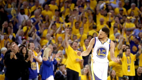 OAKLAND, CA - JUNE 12:  Stephen Curry #30 of the Golden State Warriors reacts after a play against the Cleveland Cavaliers in Game 5 of the 2017 NBA Finals at ORACLE Arena on June 12, 2017 in Oakland, California. NOTE TO USER: User expressly acknowledges and agrees that, by downloading and or using this photograph, User is consenting to the terms and conditions of the Getty Images License Agreement.  (Photo by Ezra Shaw/Getty Images)