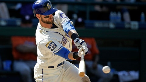 Seattle Mariners' Mitch Haniger grounds into a fielder's choice to end a baseball game against the Houston Astros in the ninth inning Sunday, June 25, 2017, in Seattle. (AP Photo/Elaine Thompson)