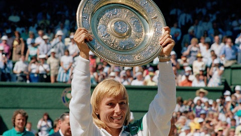 FILE - In this July 4, 1987, file photo, Martina Navratilova holds up her trophy after winning the women's singles championship on the Centre Court at Wimbledon, England. (AP Photo/Robert Dear, File)