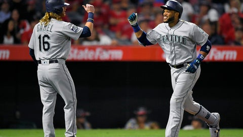 Seattle Mariners' Robinson Cano, right, is congratulated by Ben Gamel after hitting a two-run home run during the seventh inning of the team's baseball game against the Los Angeles Angels, Friday, June 30, 2017, in Anaheim, Calif. (AP Photo/Mark J. Terrill)
