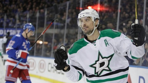 Dallas Stars' Patrick Sharp (10) celebrates after scoring a goal as New York Rangers' Nick Holden (22) skates in the background during the first period of an NHL hockey game Tuesday, Jan. 17, 2017, in New York. (AP Photo/Frank Franklin II)