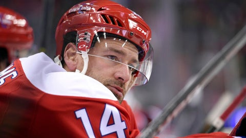 FILE - In this Jan. 13, 2017, file photo, Washington Capitals right wing Justin Williams (14) looks on during the third period of an NHL hockey game against the Chicago Blackhawks in Washington. The Carolina Hurricanes opened free agency Saturday, Jauly 1, 2017,  by bringing back 35-year-old forward Justin Williams on a two-year deal worth $9 million.  (AP Photo/Nick Wass, File)