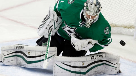 FILE - In this Dec. 29, 2016, file photo, Dallas Stars goalie Antti Niemi (31) blocks a shot on goal during the third period of an NHL hockey game against the Colorado Avalanche in Dallas. The Stanley Cup champion Pittsburgh Penguins will look a lot different as they go for a three-peat. The Penguins signed defenseman Matt Hunwick and goaltender Antti Niemi and lost defensemen Trevor Daley and Ron Hainsey and center Nick Bonino on the first day of free agency on Saturday, July 1, 2017.  (AP Photo/LM Otero, File)