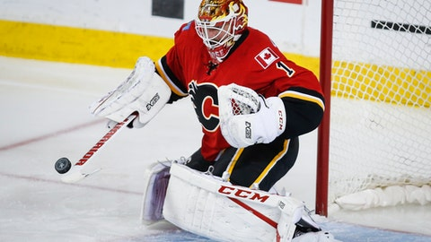 """FILE - In this April 19, 2017, file photo, Calgary Flames goalie Brian Elliott swats away the puck during the first period against the Anaheim Ducks in Game 4 in a first-round NHL hockey Stanley Cup playoff series in Calgary, Alberta. """"With the spots open to play a majority of the games and be a major contributor and not a backup, there weren't that many spots,"""" Elliott said after signing a $5.5 million deal worth $2.75 million each season with the Philadephia Flyers. """"You kind of knew what was out there and knew what everybody was thinking, so you just make your decision from there."""" (Jeff McIntosh/The Canadian Press via AP, File)"""