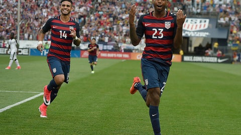 United States' Kellyn Acosta celebrates his goal against Ghana as teammate United States' Dom Dwyer, left, smiles behind him during an international friendly soccer match at Pratt & Whitney Stadium at Rentschler Field, Saturday, July 1, 2017, in East Hartford, Conn. The USA won 2-1. (AP Photo/Jessica Hill)