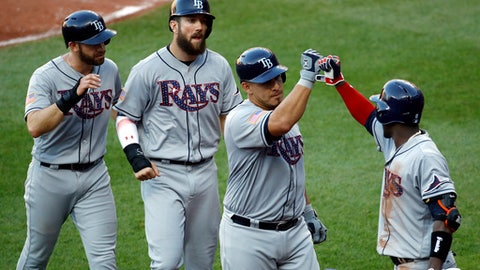 Tampa Bay Rays' Wilson Ramos, second from right, fist-bumps teammate Adeiny Hechavarria after batting in Evan Longoria, left, and Steven Souza Jr., second from left, on a home run in the fifth inning of a baseball game against the Baltimore Orioles in Baltimore, Saturday, July 1, 2017. (AP Photo/Patrick Semansky)