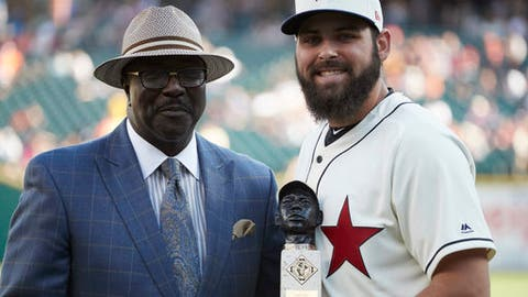 "Detroit Tigers starting pitcher Michael Fulmer, right, receives the ""Larry Doby Legacy Award for American League Rookie of the Year"" award from Bob Kendrick, president of the Negro Leagues Baseball Museum, prior to the second baseball game of a doubleheader against the Cleveland Indians in Detroit, Saturday, July 1, 2017. (AP Photo/Rick Osentoski)"