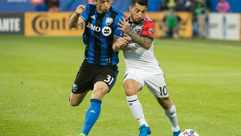 Montreal Impact's Blerim Dzemaili, left, challenges D.C. United's Luciano Acosta during the second half of an MLS soccer match Saturday, July 1, 2017, in Montreal. (Graham Hughes/The Canadian Press via AP)
