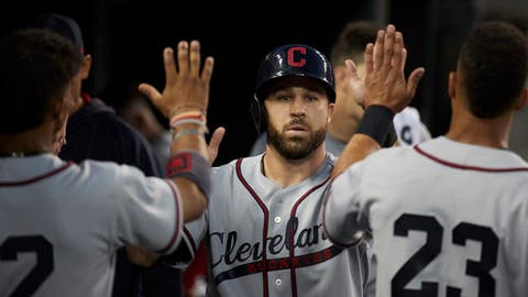 Cleveland Indians Jason Kipnis is congratulated by teammates after scoring against the Detroit Tigers during the sixth inning in the second baseball game of a doubleheader in Detroit, Saturday, July 1, 2017. (AP Photo/Rick Osentoski)