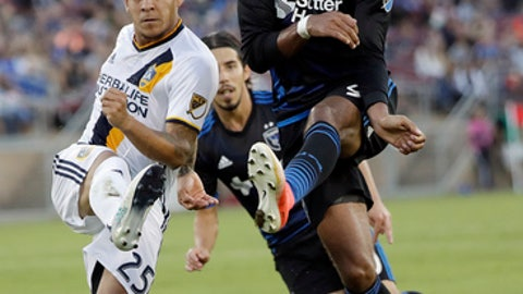 Los Angeles Galaxy defender Rafael Garcia, left, clears the ball next to San Jose Earthquakes forward Danny Hoesen during the first half of an MLS soccer match Saturday, July 1, 2017, in San Jose, Calif. (AP Photo/Marcio Jose Sanchez)