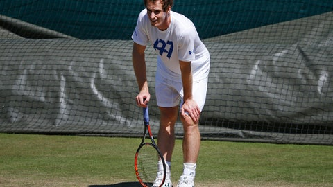 Britain's Andy Murray rests between shots during a practice session ahead of the Wimbledon Tennis Championships in London, Sunday, July 2, 2017. (AP Photo/Alastair Grant)