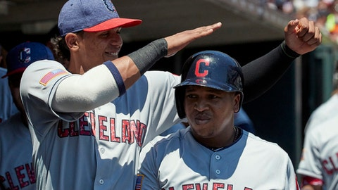 Cleveland Indians' Jose Ramirez, right, is congratulated by Erik Gonzalez, left, after hitting a home run against the Detroit Tigers during the third inning of a baseball game in Detroit, Sunday, July 2, 2017. (AP Photo/Rick Osentoski)