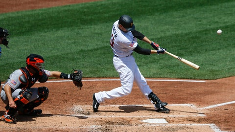 Pittsburgh Pirates' Jordy Mercer, right, hits a two-run home run in front of San Francisco Giants catcher Buster Posey in the fourth inning of a baseball game, Sunday, July 2, 2017, in Pittsburgh. (AP Photo/Keith Srakocic)