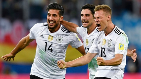 Germany's Emre Can, Lars Stindl and Joshua Kimmich, from left, celebrate after winning the Confederations Cup final soccer match between Chile and Germany, at the St.Petersburg Stadium, Russia, Sunday July 2, 2017. (AP Photo/Martin Meissner)