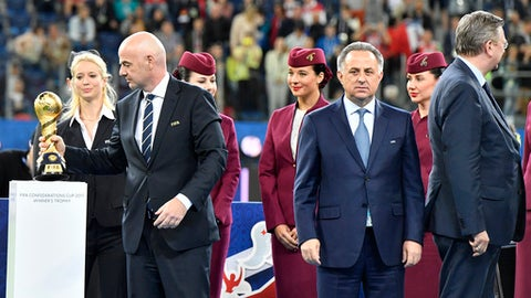 FIFA President Gianni Infantino, Russian Deputy-Prime minister and head of the World Cup 2018 organizing committee Vitaly Mutko and Reinhard Grindel, head of the German soccer federation after Germany won 1-0 in the Confederations Cup final soccer match between Chile and Germany, at the St.Petersburg Stadium, Russia, Sunday July 2, 2017. (AP Photo/Martin Meissner)