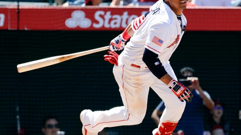 Los Angeles Angels' Yunel Escobar watches his RBI-single against the Seattle Mariners during the seventh inning of a baseball game in Anaheim, Calif., Sunday, July 2, 2017. (AP Photo/Chris Carlson)