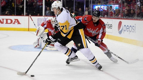 Pittsburgh Penguins center Evgeni Malkin (71), of Russia, skates with the puck against Washington Capitals center Evgeny Kuznetsov (92), right, during the first period of an NHL hockey game, Wednesday, Nov. 16, 2016, in Washington. (AP Photo/Nick Wass)