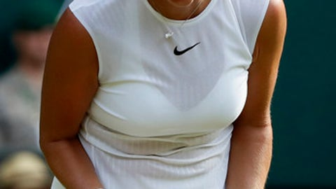 Czech Republic's Petra Kvitova reacts during her Women's Singles Match against Sweden's Johanna Larsson on the opening day at the Wimbledon Tennis Championships in London Monday, July 3, 2017. (AP Photo/Kirsty Wigglesworth)