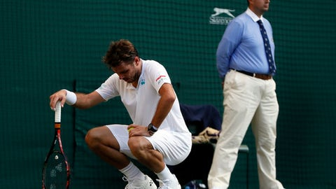 Switzerland's Stan Wawrinka during his Men's Singles Match against Russia's Daniil Medvedev on the opening day at the Wimbledon Tennis Championships in London Monday, July 3, 2017. (AP Photo/Kirsty Wigglesworth)