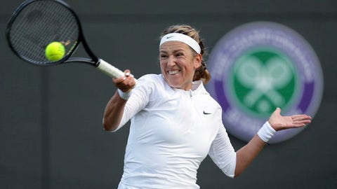 Victoria Azarenka of Belarus plays a return to CiCi Bellis of the United States during their Women's Singles Match on the opening day at the Wimbledon Tennis Championships in London Monday, July 3, 2017. (AP Photo/Tim Ireland)
