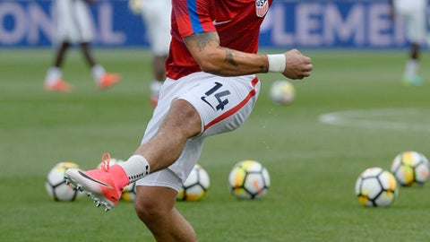 FILE - In this July 1, 2017, file photo, United States' Dom Dwyer warms up before the team's international friendly soccer match against Ghana in East Hartford, Conn. Dwyer and Sydney Leroux were born abroad, came to the United States and dreamed of playing for the national team. Along the way they also found each other. (AP Photo/Jessica Hill, File)