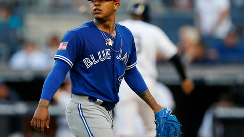 Toronto Blue Jays starting pitcher Marcus Stroman (6) leaves the mound after walking in two runs during a baseball game against the New York Yankees in New York, Monday, July 3, 2017. (AP Photo/Kathy Willens)