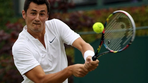 Australia's Bernard Tomic returns to Germany's Mischa Zverev during their Men's Singles Match on day two at the Wimbledon Tennis Championships in London Tuesday, July 4, 2017. (AP Photo/Alastair Grant)
