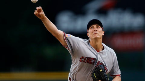 Cincinnati Reds starting pitcher Homer Bailey delivers a pitch to Colorado Rockies' Raimel Tapia in the first inning of a baseball game Tuesday, July 4, 2017, in Denver. (AP Photo/David Zalubowski)