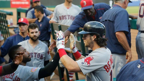 Boston Red Sox left fielder Andrew Benintendi (16) is congratulated by teammates after he scored during the second inning of a baseball game against the Texas Rangers, Tuesday, July 4, 2017, in Arlington, Texas. (AP Photo/Michael Ainsworth)