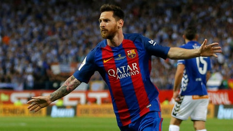 In this  Saturday May 27, 2017 file photo, Barcelona's Lionel Messi celebrates after scoring a goal during the Copa del Rey final soccer match between Barcelona and Alaves at the Vicente Calderon stadium in Madrid, Spain. Barcelona said Wednesday July 5, 2017, Argentina forward Lionel Messi has agreed to extend his contract that will tie him to the Spanish club through June 30, 2021. (AP Photo/Daniel Ochoa de Olza, File)