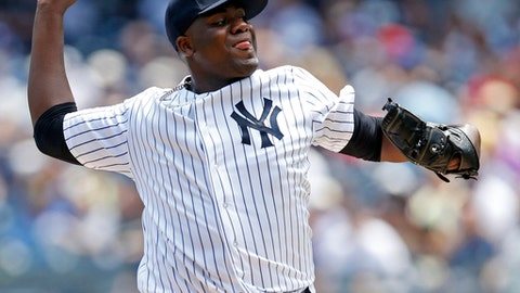 New York Yankees starting pitcher Michael Pineda winds up for a pitch during the first inning of a baseball game against the Toronto Blue Jays in New York, Wednesday, July 5, 2017. (AP Photo/Kathy Willens)